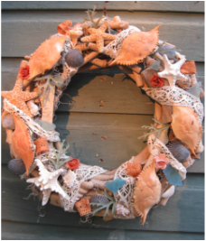 Beautiful driftwood wreath with shells and lace. Learn how to make your own at www.shellcrafter.com