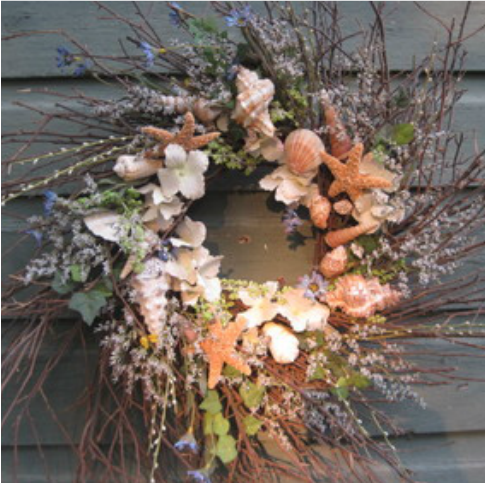 Rustic twig wreath with shells and flowers. Learn how to make this at www.shellcrafter.com