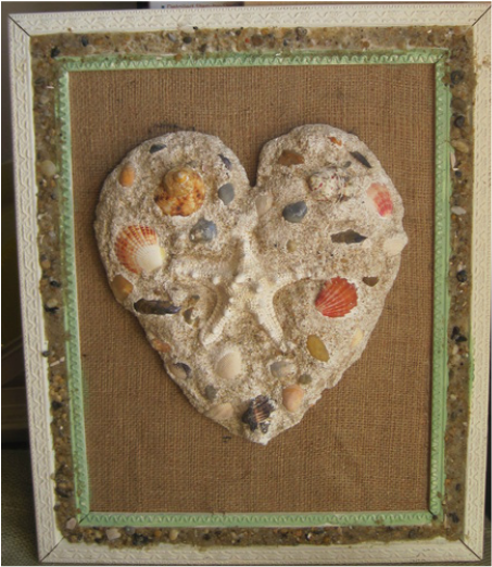 Beach decor, DIY plaster, sand cast heart. Tutorial at www.shellcrafter.com